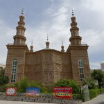 Local Mosque. The front signage forbids Communist Party Members from entering the premise.